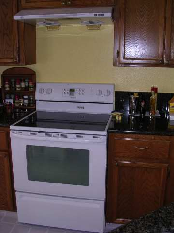 New Maytag electric smooth-top stove and Zephyr hood